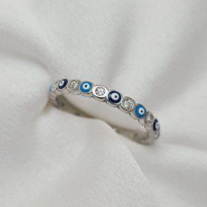 טבעת כסף 925 עיניים כחולות ועיגולים כסופים ומשובצי זרקונים