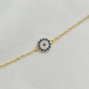 """צמיד כסף 925 בציפוי זהב """"לני"""" בשילוב עין משובצת זרקוניה כחולה שקופה"""